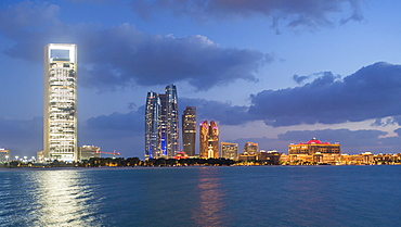 Etihad Towers and Emirates Palace hotel viewed from the Breakwater, Abu Dhabi, United Arab Emirates, Middle East