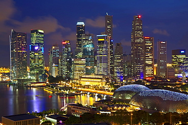 Skyline of Financial district illuminated at dusk, Singapore, Southeast Asia, Asia