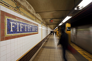Subway station and train in motion, Manhattan, New York City, New York, United States of America, North America