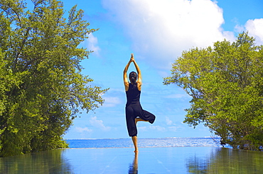 Yoga meditation, Full Moon Island, Male Atoll, Maldives, Indian Ocean, Asia