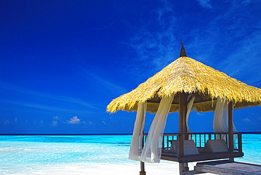 Jetty with straw roof, Maldives, Indian Ocean, Asia
