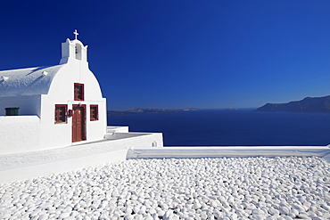 Church and white stones at Oia, Santorini, Cyclades, Greek Islands, Greece, Europe