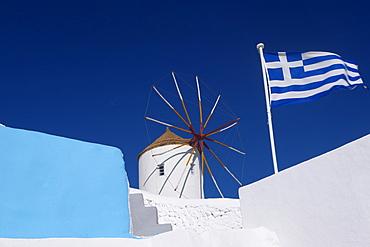 Church, windmill and Greek flag, Santorini, Cyclades, Greek Islands, Greece, Europe