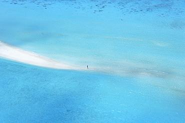 Woman walking on sandbank, Maldives, Indian Ocean, Asia
