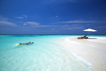 Couple snorkelling in Maldives, Indian Ocean, Asia