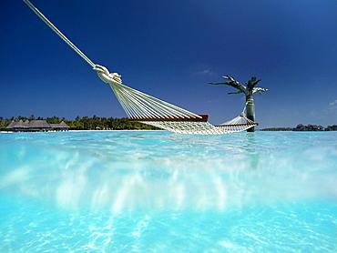 Hammock in the lagoon at Gili Lankanfushi Resort, Maldives, Indian Ocean, Asia