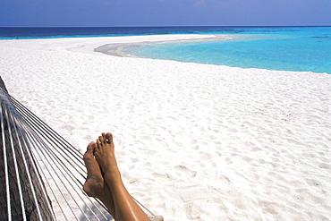 Woman barefoot in hammock, Maldives, Indian Ocean, Asia - 795-89