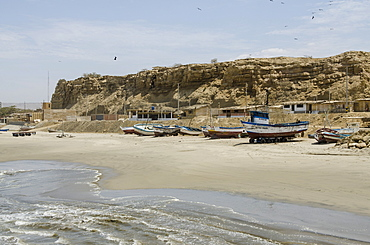Fishing boats on beach Los Organos village near Mancora, Peru, South America