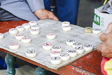 Playing xiangqi (Chinese chess) at the Temple of Heaven (Altar of Heaven), Beijing, China, Asia