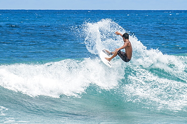 Surfing at Sunset Beach, North Shore, Oahu, Hawaii, United States of America, Pacific