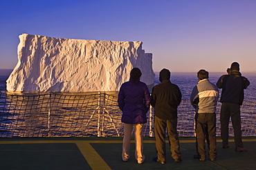 Passengers viewing iceberg in the Gerlache Strait, Antarctica, Polar Regions
