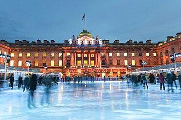 England, London, Skating on the seasonal ice rink at Somerset House.