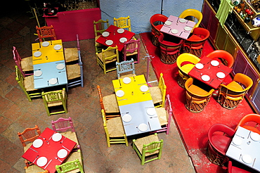 Mexico, Bajio, Queretaro, Elevated view looking down on tables in colourful restaurant interior.