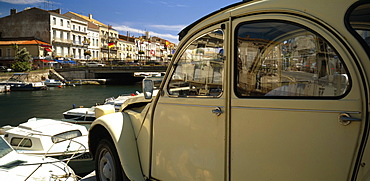 FRANCE Herault Sete.  Part view of harbour and waterside buildings with white citroen car in the foreground.