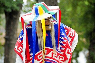 Mexico, Michoacan, Patzcuaro, Dancer in mask and costume performing Danza de los Viejitos or Dance of the Little Old Men in Plaza Vasco de Quiroga.