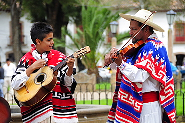Mexico, Michoacan, Patzcuaro, Musicians playing violin and guitar during performance of Danza de los Viejitos or Dance of the Little Old Men in Plaza Vasco de Quiroga.