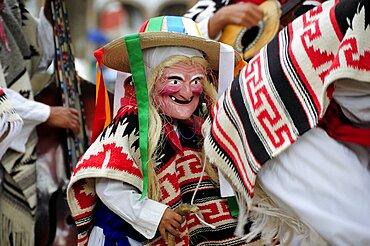 Mexico, Michoacan, Patzcuaro, Child wearing mask and costume for Danza de los Viejitos or Dance of the Little Old Men in Plaza Vasco de Quiroga.