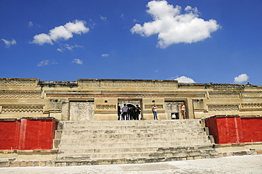 Mexico, Oaxaca, Mitla, Archaeological site Templo de las Columnas with tourist visitors standing at top of steps to entrance.