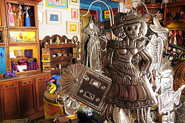 Mexico, Oaxaca, Shop interior with hojalata tin artwork displayed for sale.