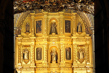 Mexico, Oaxaca, Church of Santo Domingo Interior with carved and gilded altarpiece with paintings and painted sculpted figures.