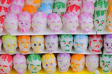 Mexico, Puebla, Sugar candies in the shape of skulls for Dia de los Muertos or Day of the dead celebrations.