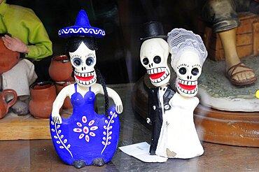 Mexico, Oaxaca, Skull figures for Dia de los Muertos or Day of the Dead festivities.