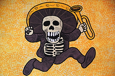 Mexico, Bajio, Queretaro, Wall art depicting skeleton in sombrero holding a trumpet.