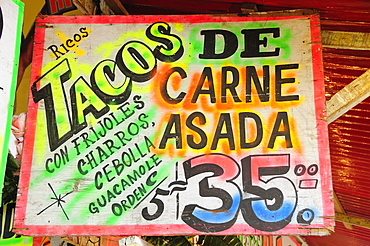 Mexico, Bajio, Zacatecas, Sign for taco food stall with highlighted text and price.