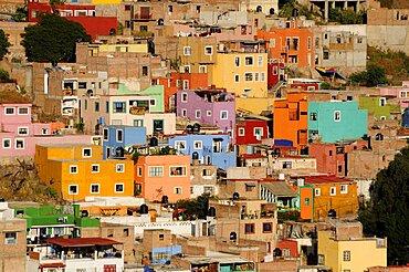 Mexico, Bajio, Guanajuato, View over brightly coloured houses spread out over hillside.