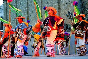 Mexico, Jalisco, Guadalajara, Plaza Tapatia Dancers from Guerrero State performing at carnival.