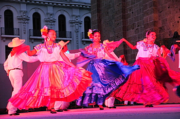 Mexico, Jalisco, Guadalajara, Plaza Tapatia Folk dancers from Oaxaca State perform at carnival.