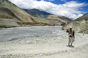 Nepal, Upper Mustang, Kali Gandaki gorge, Man returning from worship.