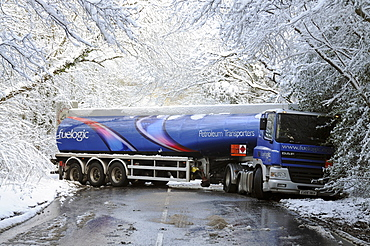 Weather, Winter, Snow, Jack-knifed fuel tanker on icy A22 main road near Nutley East Sussex after heavy snowfall. Truck has spun and is facing in the opposite direction to the one it was travelling in.