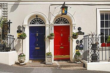Ireland, County Cork, Kinsale, colourful doorways of terraced houses.