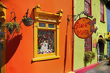 Ireland, County Cork, Kinsale, Colourful facades in market place with flower pots.