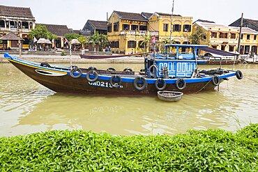 Vietnam, Quang Nam Province, Hoi An, Fishing boat moored on Thu Bon River.