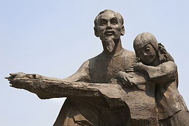 Vietnam, Ho Chi Minh City, Statue of Ho Chi Minh holding a child outside the Peoples Committee Building.