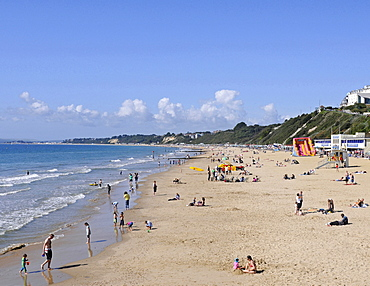 England, Dorset, Bournemouth, View over beach with families sunbathing and Life Guard station.