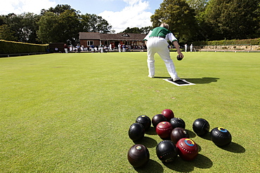 England, East Sussex, Uckfield, People playing flat lawn bowls at local club.