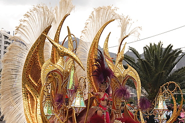 Spain, Canary Islands, Tenerife, Santa Cruz Latin carnival Golden pterodactyls float.