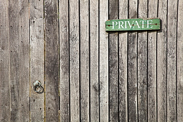England, West Sussex, Chichester, Architecture Doors Detail of wooden gate and fence with priavte sign.