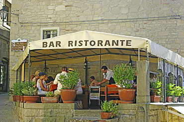 Republic of San Marino, San Marino City, Tourists sat in outdoor restaurant.