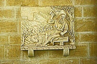 Republic of San Marino, San Marino City, Relief art on wall.