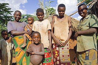 Burundi, Cibitoke Province, Kirundo, Burundi Kirundo A family beside the road living in poverty child with obvious worms.