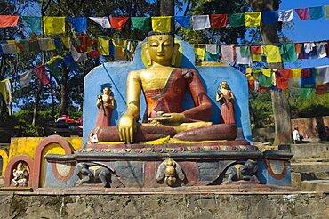 Nepal, Kathmandu, Buddha statue at the foot of the Swayambunath Monkey Temple.