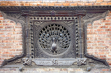 Nepal, Bhaktapur, The famous Peacock Window in streets of the old quarter.