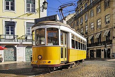Portugal, Estremadura, Lisbon, Praco do Fiqueira yellow tram number 28 entering the square.