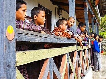 Bhutan, Mongar, Schoolchildren standing outside class.