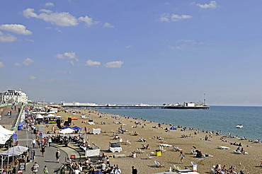 England, East Sussex, Brighton, View along the promenade and beach.