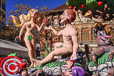 Spain, Valencia Province, Valencia, Papier Mache figures of Adam and Eve in the garden during Las Fallas festival.